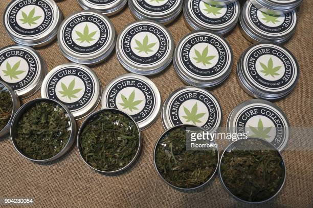 Tins of marijuana leaves from the Cann Cure Collective sit on display at the 1st International Cannabis Expo at the Faliro Sports Pavilion in Athens...