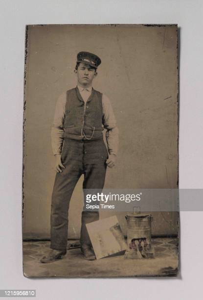 Tinsmith with Coal Heater and Sheet of Tin, 1870s-80s, Tintype, Image: 9.5 x 5.9 cm , Photographs, Unknown .