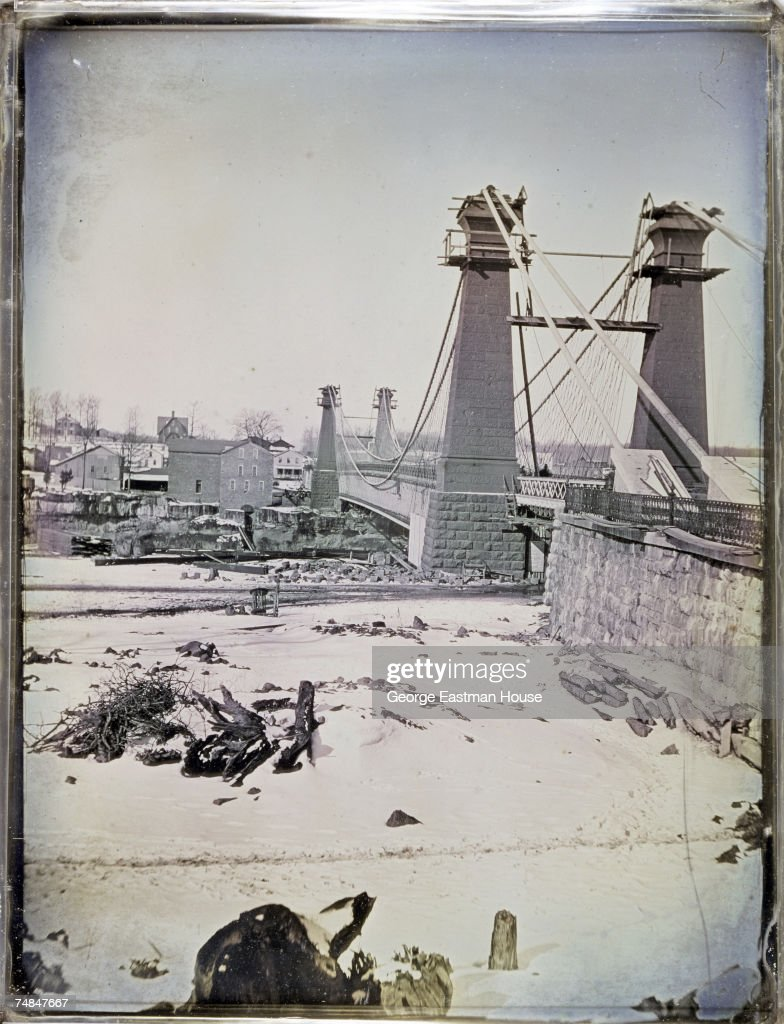 Tinted daguerreotype of the second Niagara Falls Suspension Bridge (John Augustus Roebling, 1855) shortly before its completion, Niagra Falls, Ontario & New York, early 1855. The bridge opened on March 18 (the first train crossing occured 10 days earlier), and was replaced in 1897.