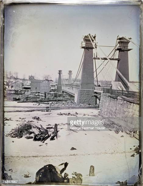 Tinted daguerreotype of the second Niagara Falls Suspension Bridge shortly before its completion Niagra Falls Ontario New York early 1855 The bridge...