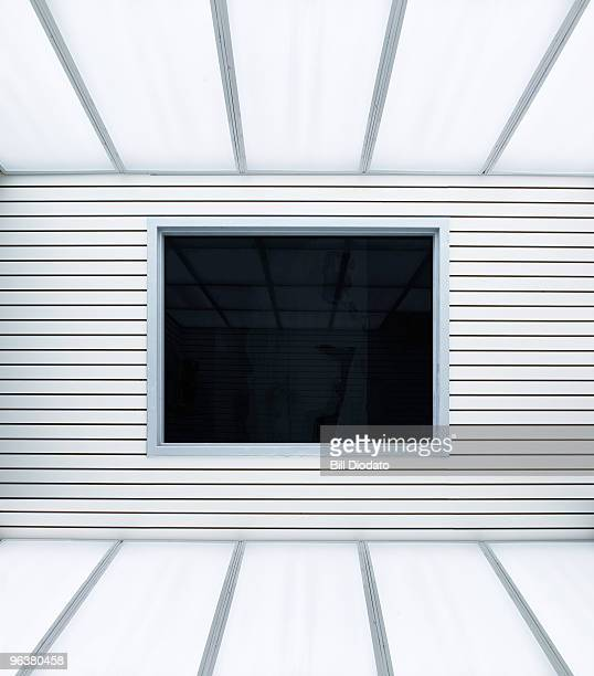 tinted reflected window indoors in white room