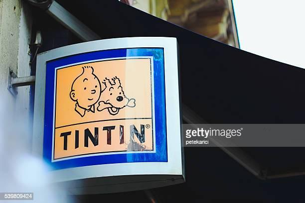 tintin shop sign in paris - tintin stock photos and pictures