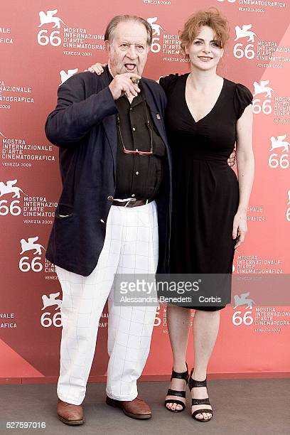 "Tinto Brass and Caterina Varzi attend the photocall of the short film ""Hotel Courbet"" during the 66th Venice Film Festival."