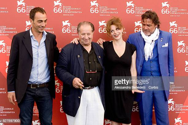 "Tinto Brass, Vincenzo and Caterina Varz,i and Alberto Patrolini attend the photocall of the short film ""Hotel Courbet"" during the 66th Venice Film..."