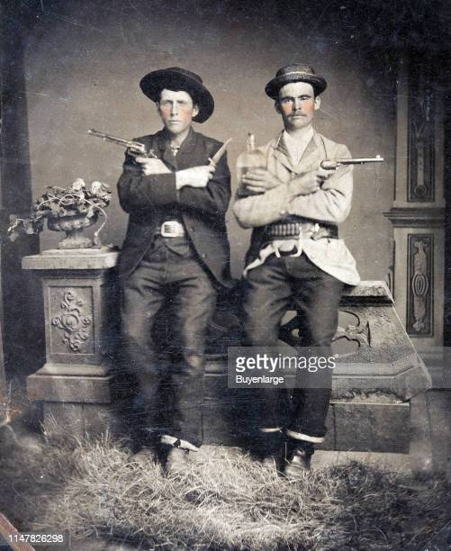Tintype Of Two WellArmed Western Gents Circa 1885 Both Hold 7½' Barrel Colt Single Action Revolvers The Figure At Left With A Bowie Knife While The...