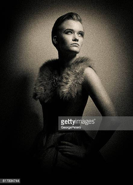 Tintype photo of woman with dramatic lighting