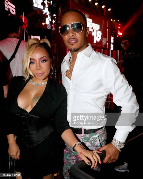 Tiny and T.I. Are seen backstage during the BET Hip Hop Awards 2018 at Fillmore Miami Beach on October 6, 2018 in Miami Beach, Florida.