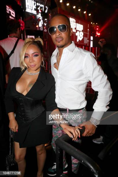 Tiny and TI are seen backstage during the BET Hip Hop Awards 2018 at Fillmore Miami Beach on October 6 2018 in Miami Beach Florida