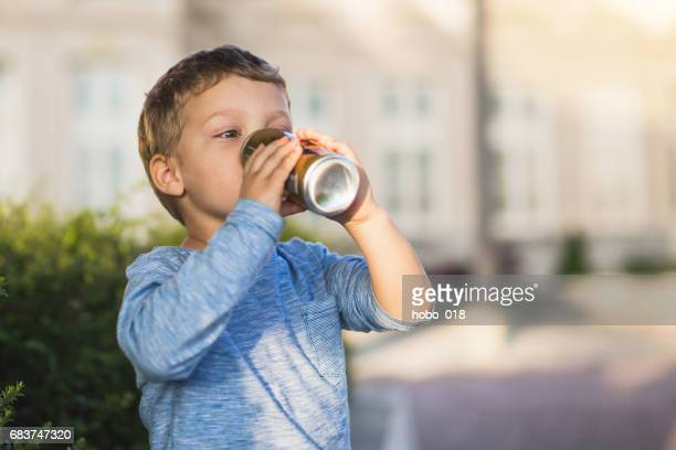 Tiny baby boy drink jucie
