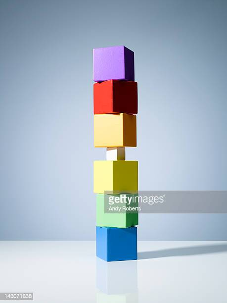 Tiny block in stack of colorful cubes