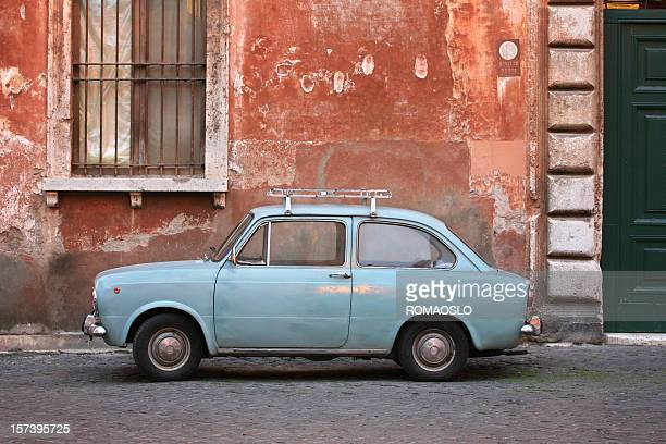 Tiny blue vintage car in Rome Italy