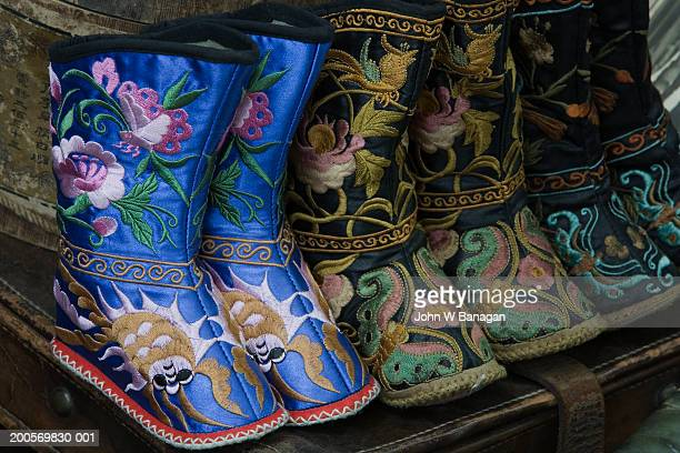 Tiny boots for bound feet on market hawker stall