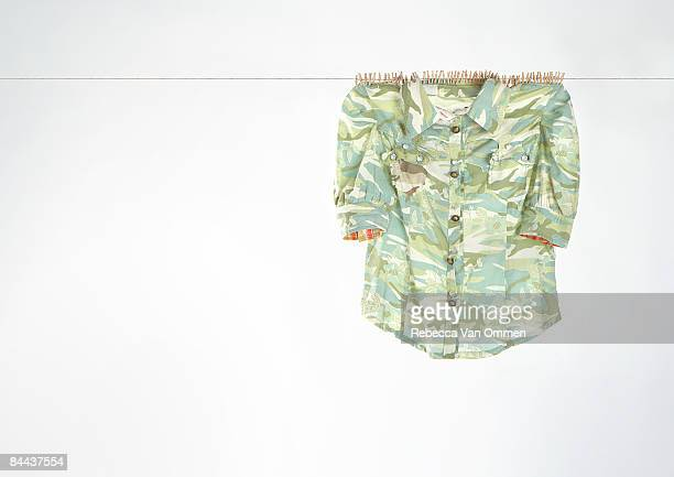 Tiny clothes pegs holding up a shirt