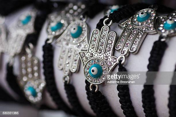 tiny evil eye hands - hand of fatima stock photos and pictures