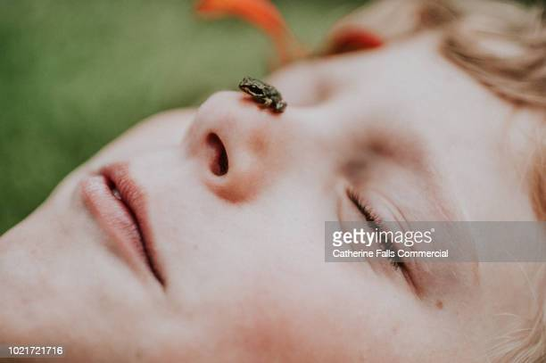 Tiny frog on a child's nose