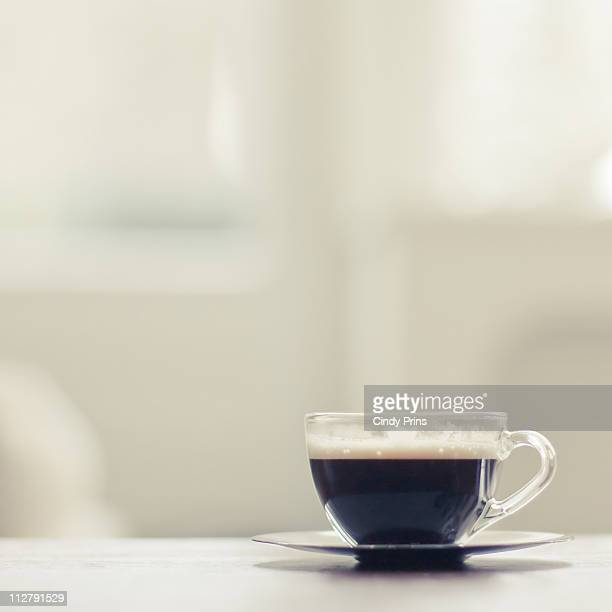 Tiny glass cup of espresso coffee