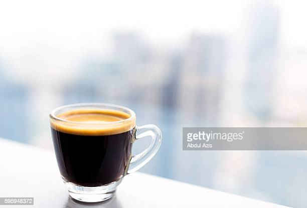 tiny glass cup of espresso coffee - espresso stock photos and pictures