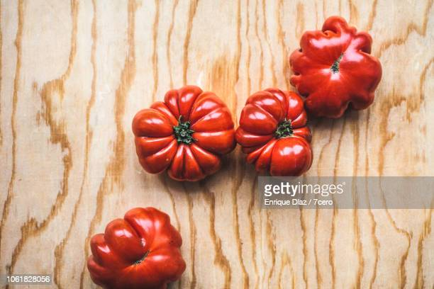 tiny heirloom tomatoes on pine plywood - imperfection stock pictures, royalty-free photos & images
