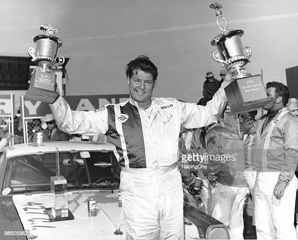 Tiny Lund in victory lane after he drove Bondy Long's Ford Fairlane to victory in the Permatex 300 at Daytona International Speedway for late model...