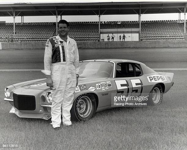 Tiny Lund takes a few pictures next to his Pontiac before the Mr D's 200 Lund would finish 8th on May 13 1972
