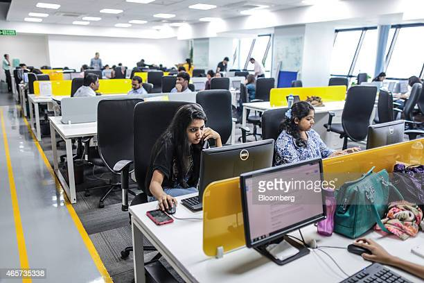 Tiny Owl employees work at computers inside the company's head office in Mumbai India on Monday March 9 2015 Tiny Owl is a smartphone application...