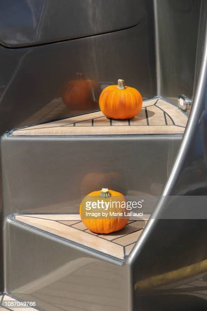 Tiny pumpkins on the steps of a yacht