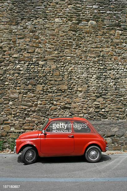 Tiny red vintage car in Florence, Italy