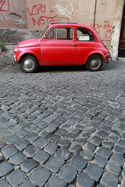 Tiny red vintage car in Rome, Italy