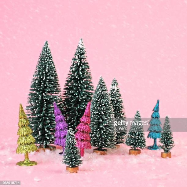 Tiny trees on pink background with snow