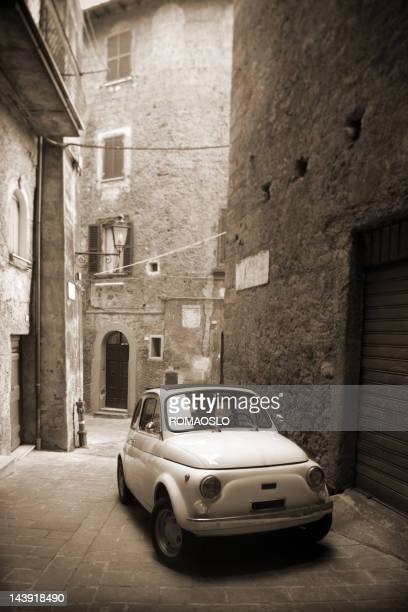 Tiny vintage car in an alley, Lazio Italy