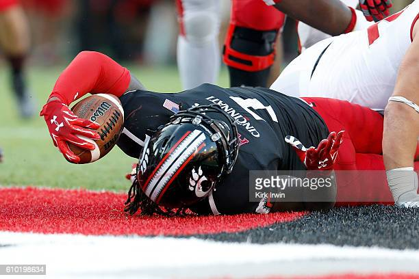 Tion Green of the Cincinnati Bearcats falls into the endzone to score the game winning touchdown during the fourth quarter of the game against the...