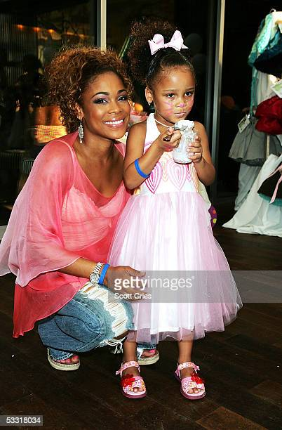 Tionne T Boz Watkins of TLC and her daughter Chase Rolison pose for a photo during a fashion show and party to benefit the Make A Wish Foundation at...