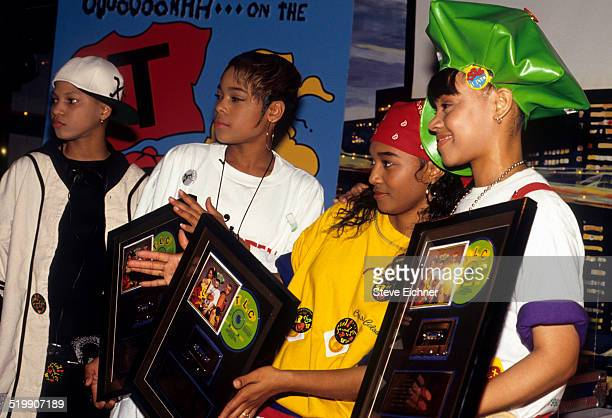 Tionne 'T-Boz' Watkins, Rozonda 'Chilli' Thomas, and Lisa 'Left Eye' Lopes of TLC at Gold record presentation, New York, April 15, 1992.