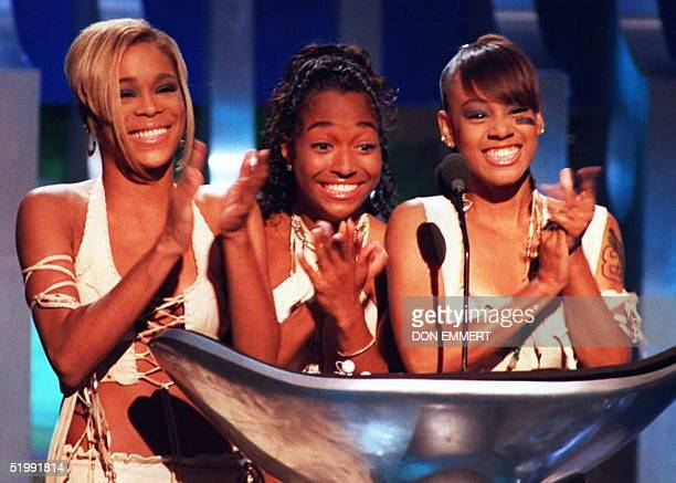 Tionne TBoz Watkins Rozonda Chilli Thomas and Lisa Left Eye Lopes of the group TLC celebrate their award for Best RampB Video 07 September during the...
