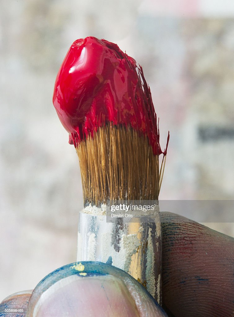 Tip of paint brush with blob of red oil paint : Stock Photo