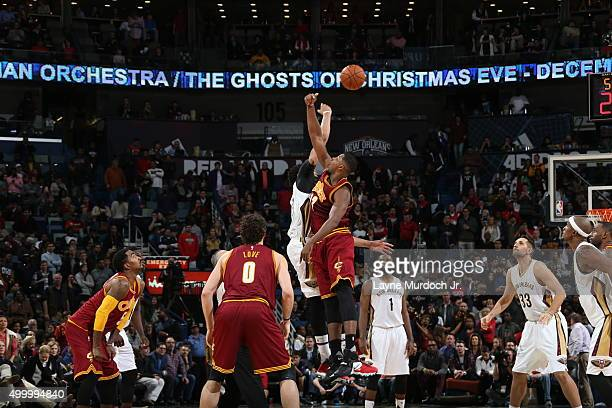 Tip off at the start of overtime between the Cleveland Cavaliers and New Orleans Pelicans on December 4 2015 at the Smoothie King Center in New...