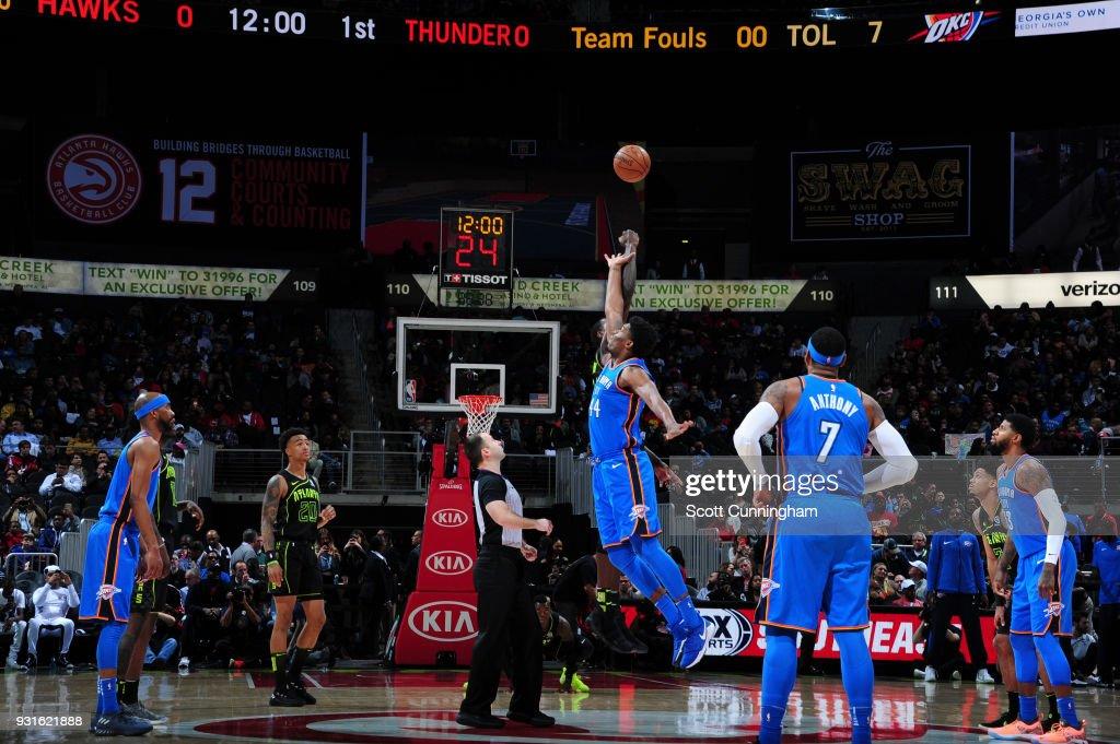 Tip off between Dewayne Dedmon #14 of the Atlanta Hawks and Dakari Johnson #44 of the Oklahoma City Thunder on March 13, 2018 at Philips Arena in Atlanta, Georgia.