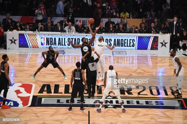 Tip off between Team LeBron and Team Stephen during the 2018 NBA AllStar Game on February 18 at the Staples Center in Los Angeles California / AFP...