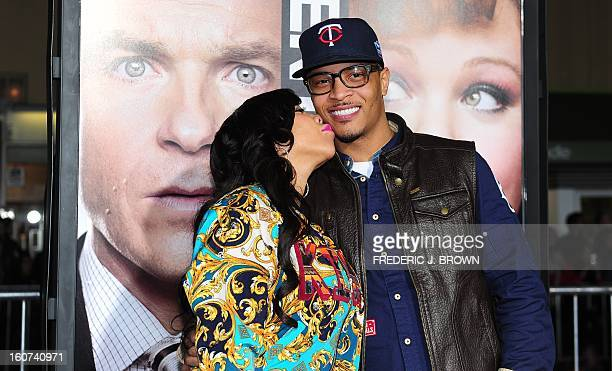 """Tip """"T.I"""" Harris receives a kiss from his wife Tameka Cottle while posing on arrival for the world premiere of the film 'Identity Thief' in Los..."""