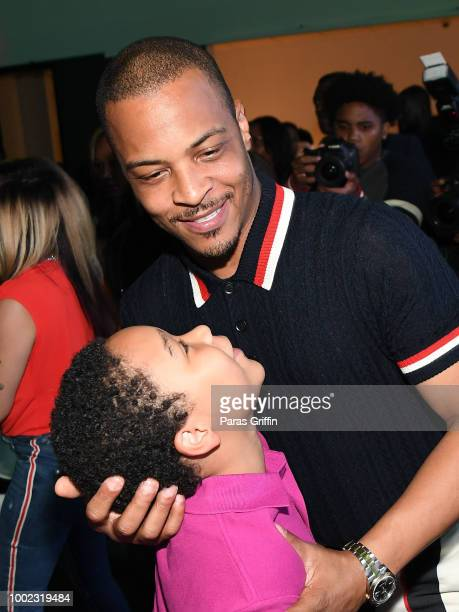 Tip 'TI' Harris with his son Major Harris attend 'The Grand Hustle' Exclusive Viewing Party at The Gathering Spot on July 19 2018 in Atlanta Georgia