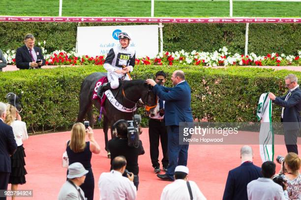 Tip Two Win under David Probert are congratulated in the winners circle by trainer Roger Teal after winning the 1600m Group 2 Al Biddah Mile race at...