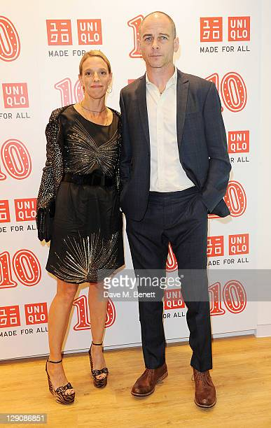 Tiphaine de Lussy and Dinos Chapman arrive at the reopening of the UNIQLO London Flagship store on Regent Street on October 12, 2011 in London,...