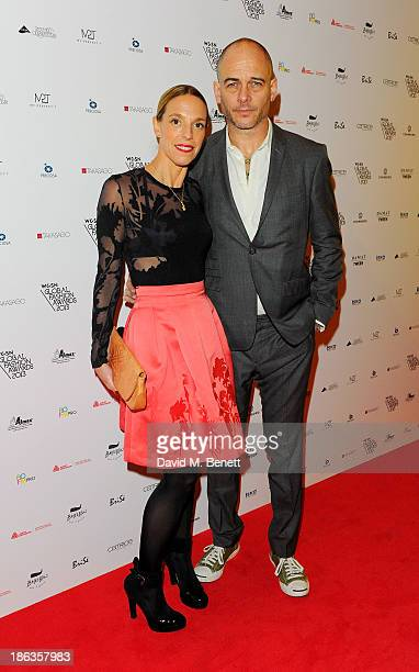 Tiphaine de Lussy and Dinos Chapman arrive at The WGSN Global Fashion Awards at the Victoria Albert Museum on October 30 2013 in London England