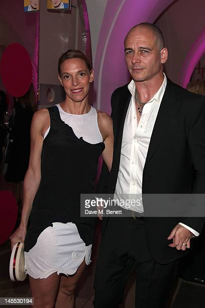 Tiphaine de Lussy and Dinos Chapman attend The 2012 NSPCC Pop Art Ball, co hosted by Natalia Vodianova and Stella McCartney, in aid of the NSPCC's...