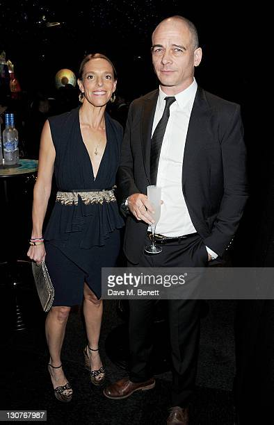 Tiphaine de Lussy and Dinos Chapman attend the Grey Goose Winter Ball to benefit the Elton John AIDS Foundation at Battersea Evolution on October 29,...