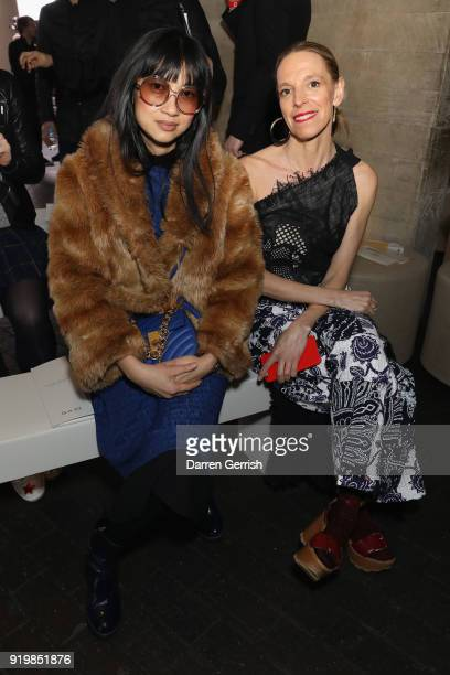 Tiphaine de Lussy and Mimi Xu attend the Roland Mouret show during London Fashion Week February 2018 at The National Theatre on February 18 2018 in...
