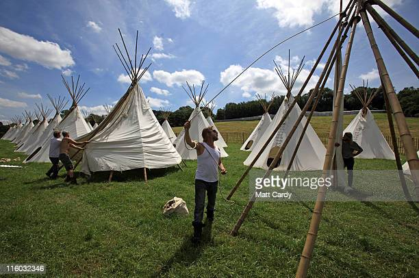 Tipis are erected at the Glastonbury Festival site at Worthy Farm, in Pilton on June 14, 2011 in Glastonbury, England. The gates open to the public a...