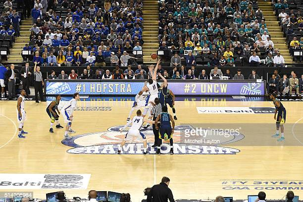 Tipoff of the Colonial Athletic Conference Championship college basketball game tournament between the North CarolinaWilmington Seahawks and the...
