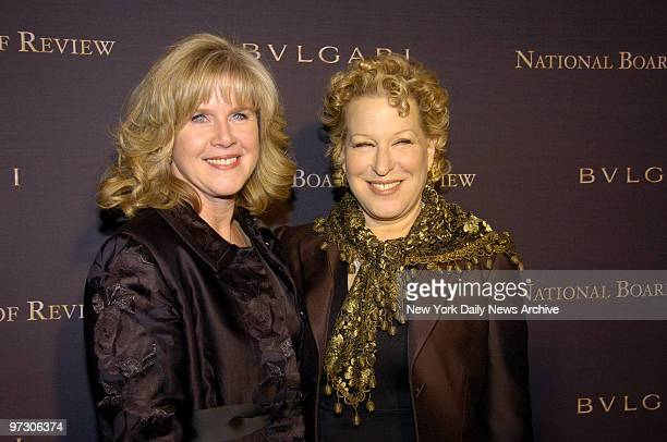 Tipper Gore who accepted the Best Documentary award on behalf of her husband Al for his documentary An Inconvenient Truth is joined by Bette Midler...