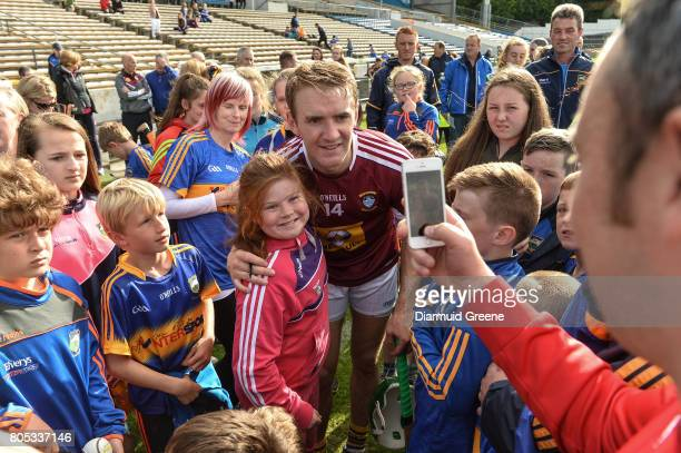 Tipperary Ireland 1 July 2017 Amy Lillis aged 10 from The Ragg Co Tipperary gets her photograph taken with Noel McGrath of Tipperary after the GAA...